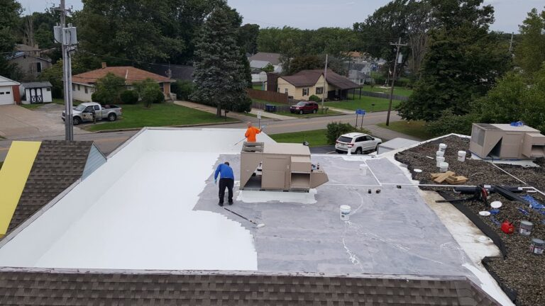 roofers applying epdm membrane during the commercial ballasted roof process