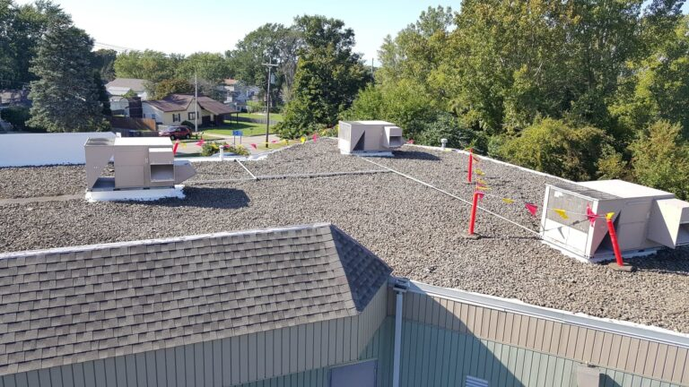 completed epdm ballasted stone commercial roof