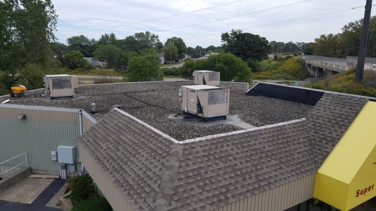 epdm ballasted stone commercial roof in need of repair
